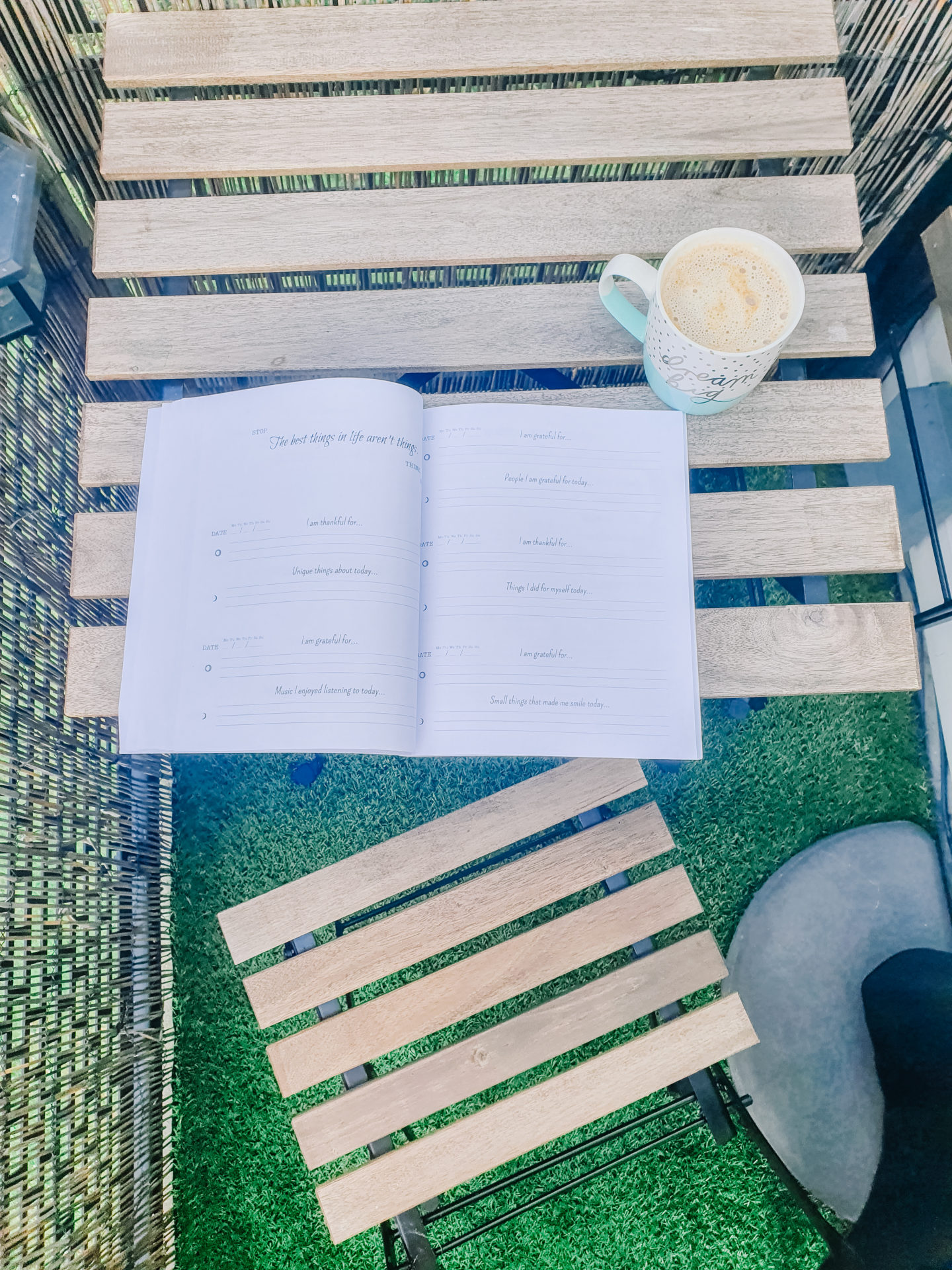 book on the table with some coffee