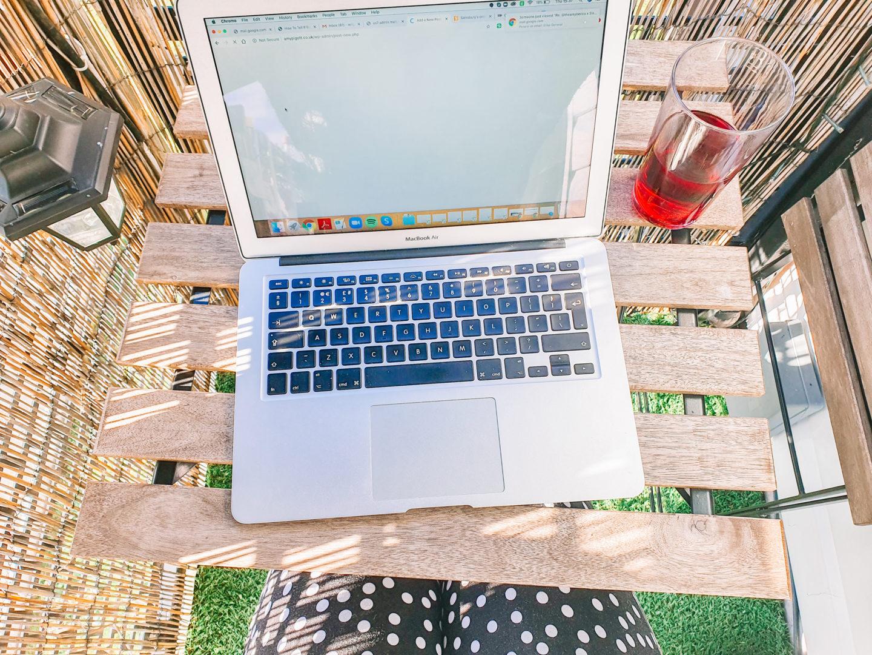 laptop on a table on a balcony